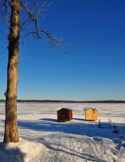 Ice Fishing huts ready to be pulled out on the lake