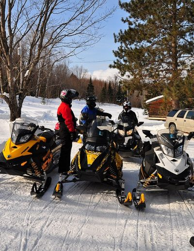 Snowmobile stop at Okimot Lodge