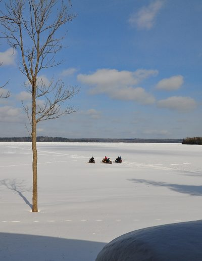Snowmobiling on Tomiko Lake